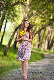 Beautiful blonde woman with yellow flowers Royalty Free Stock Image