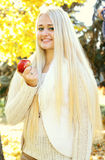 Beautiful blonde women with apple Royalty Free Stock Photo