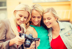 Beautiful blonde women with camera in the city Stock Images