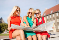 Beautiful blonde women with map in the city Royalty Free Stock Photography