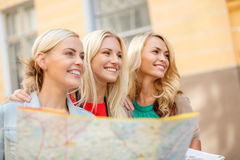 Beautiful blonde women with map in the city Royalty Free Stock Photo