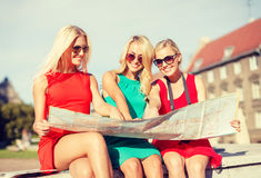 Beautiful blonde women with map in the city Stock Photography