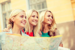 Beautiful blonde women with map in the city Stock Image