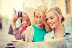 Beautiful blonde women with map in the city Royalty Free Stock Images