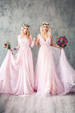 Beautiful Blonde Women in Pink Evening Gown Smiling Stock Photos