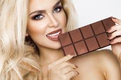 Free Beautiful, Blonde Women With Green Eyes Sensually Eating Tasty Chocolate. Stock Photos - 111920893