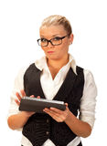 Beautiful blonde working  with her tablet computer Royalty Free Stock Image