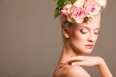 Beautiful blonde with a wreath of flowers Royalty Free Stock Image