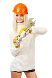 Beautiful blonde with a wrench. stock photography