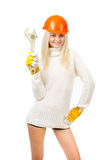 Beautiful blonde with a wrench. Royalty Free Stock Images