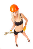 Beautiful blonde with a wrench. Royalty Free Stock Photo