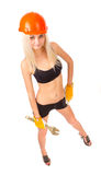 Beautiful blonde with a wrench. Royalty Free Stock Photography