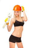 Beautiful blonde with a wrench. Stock Image