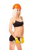 Beautiful blonde with a wrench. Stock Photos