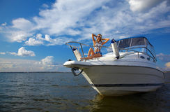 Beautiful blonde on yacht royalty free stock photo