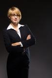 Beautiful blonde young businesswoman. Studio shot Stock Image