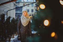 Beautiful blonde young caucasian woman in black coat and scarf Royalty Free Stock Photography