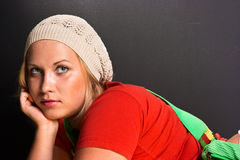 Beautiful blonde young woman. Beautiful young blonde in red shirt and white hat Royalty Free Stock Photo
