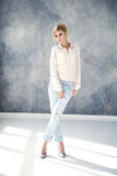 Beautiful blonde young woman in casual style. Fashion model Royalty Free Stock Image