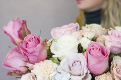 Beautiful blonde young woman holding big delicate bouquet Stock Photography