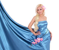 Beautiful Blonde Young Woman In Turquoise Silk Dress With Flowers Stock Images