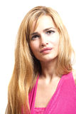 Beautiful blonde young woman in pink dress Stock Images