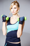 Beautiful blonde young woman in sport style Royalty Free Stock Image