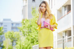Beautiful blonde young woman walking on the street Royalty Free Stock Photos
