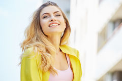 Beautiful blonde young woman walking on the street Stock Photos