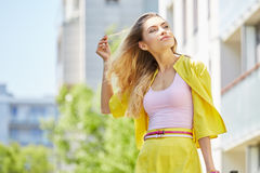 Beautiful blonde young woman walking on the street Royalty Free Stock Photography