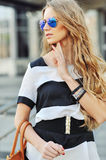 Beautiful blonde young woman wearing sunglasses - outdoor fashio Stock Photography