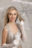 Beautiful blonde young woman with white lace gloves and umbrella Royalty Free Stock Photo