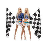 Beautiful blondes posing with checkered flags Stock Images