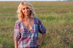 Beautiful blondie in a countryside Stock Images