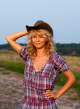 Beautiful blondie in a cowboy hat and dress Royalty Free Stock Photos