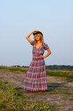 Beautiful blondie in a cowboy hat and dress Stock Image