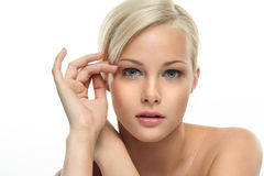 Beautiful blondie girl. Image with beautiful blondie girl on white background close-up Stock Photography