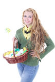 Beautiful blondie girl with easter eggs in the basket Royalty Free Stock Image