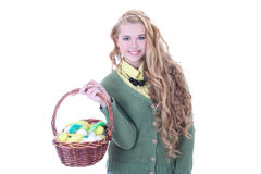Beautiful blondie girl with easter eggs in the basket over white Royalty Free Stock Photography