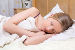 Beautiful blondie girl sleeping in bed Royalty Free Stock Photos