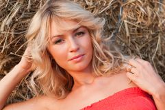 Beautiful blondie near haystack Royalty Free Stock Photography