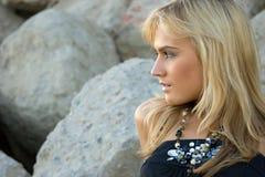 Beautiful blondie outdoors. Beautiful blondie posing against grunge background royalty free stock photos