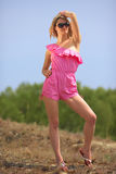 Beautiful blondie poses outdoors Stock Image