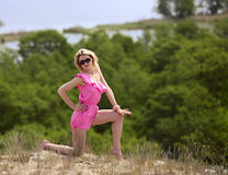 Beautiful blondie poses outdoors Royalty Free Stock Photo