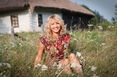 Beautiful blondie in the village Royalty Free Stock Photography