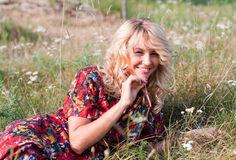 Beautiful blondie with wild flowers Stock Photo