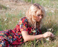 Beautiful blondie with wild flowers Royalty Free Stock Image