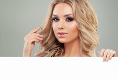 Beautiful Blondie Woman Fashion Model with White Blank Board Stock Photos