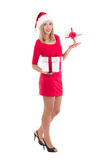 Beautiful blondie woman in santa hat with gift boxes isolated on Stock Photo