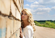 Beautiful blondy girl. & the wall Royalty Free Stock Images